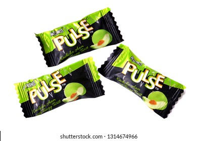 Novyy Urengoy, Russia - February 12, 2019: Indian candies Pass Pass Pulse Green Mango isolated over white background.
