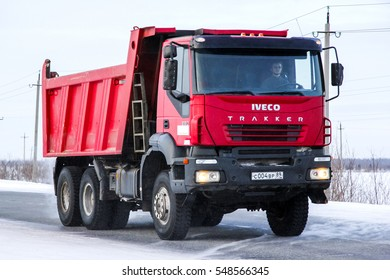 NOVYY URENGOY, RUSSIA - FEBRUARY 14, 2015: Dump truck Iveco AMT Trakker at the interurban road.