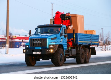 Novyy Urengoy, Russia - February 22, 2019: Flatbed truck Ural 4320 Next at the interurban road.