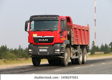 Novyy Urengoy, Russia - July 20, 2019: Red dump truck MAN TGS 40.440 at the interurban road.