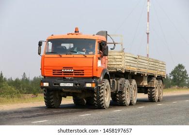 Novyy Urengoy, Russia - July 20, 2019: Offroad semitrailer truck Kamaz 44108 at the interurban road.