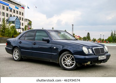 NOVYY URENGOY, RUSSIA - JULY 31, 2016: Motor car Mercedes-Benz W210 E240 in the city street.