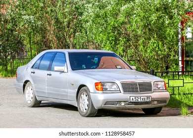 Novyy Urengoy, Russia - July 4, 2018: Silver motor car Mercedes-Benz W140 S-class in the city street.