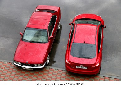 Novyy Urengoy, Russia - June 13, 2018: Red motor cars BMW (E34) 5-series and Ford Focus in the city street.