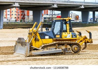 Novyy Urengoy, Russia - June 14, 2018: Modern bulldozer Komatsu D65E in the city street.