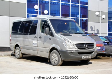 Novyy Urengoy, Russia - June 15, 2014: Grey passenger van Mercedes-Benz Sprinter in the city street.