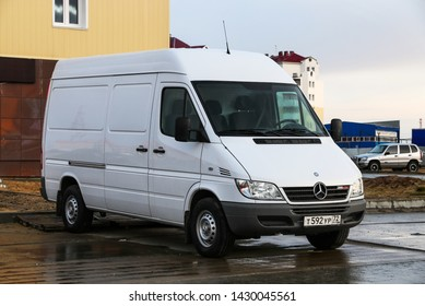 Novyy Urengoy, Russia - June 15, 2019: White cargo van Mercedes-Benz Sprinter 311CDI in the city street.