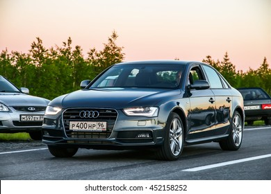 NOVYY URENGOY, RUSSIA - JUNE 17, 2016: Motor car Audi A6 at the interurban road at the background of a sunset.