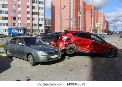 Novyy Urengoy, Russia - June 20, 2019: Crashed cars Lada Priora and Ford Focus in the city street.