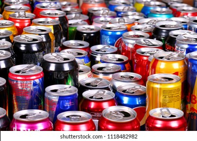 Novyy Urengoy, Russia - June 21, 2018: Many aluminium cans of sparkling drinks (Fanta, Sprite, Coca-Cola, Adrenalin Rush, Dr Pepper, Burn, Red Bull, Schweppes etc.) staying in rows.