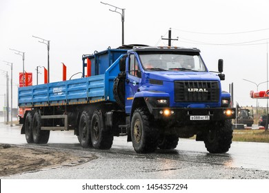 Novyy Urengoy, Russia - June 21, 2019: Semitrailer offroad truck Ural 44202 Next in the city street.