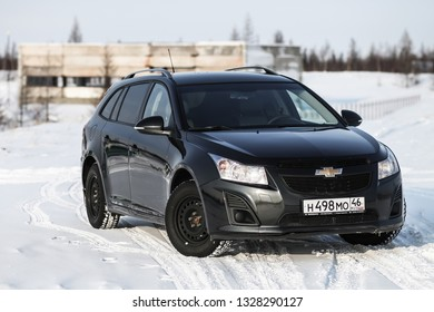 Novyy Urengoy, Russia - March 2, 2019: Black motor car Chevrolet Cruze at the countryside.
