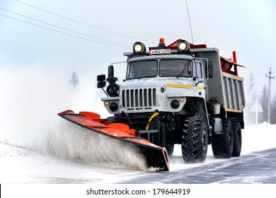 NOVYY URENGOY, RUSSIA - MARCH 2, 2014: Grey URAL snow removal vehicle at the interurban road of the Russian Extreme North.