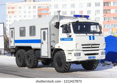 Novyy Urengoy, Russia - March 22, 2014: Police enforcer KAMAZ 5350 Mustang in the city street.