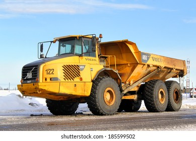 NOVYY URENGOY, RUSSIA - MARCH 5, 2014: Yellow Volvo A35D articulated dump truck at the city street.
