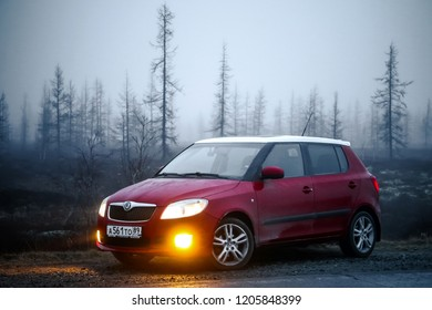 Novyy Urengoy, Russia - May 25, 2016: Red compact hatchback car Skoda Fabia SE at the countryside.