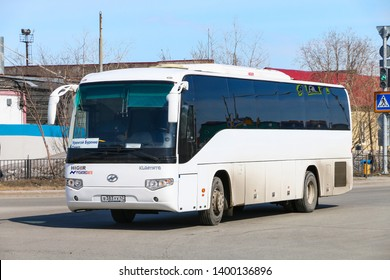 Novyy Urengoy, Russia - May 9, 2019: Interurban coach bus Higer KLQ6119TQ in the city street.