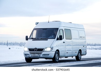 NOVYY URENGOY, RUSSIA - NOVEMBER 24, 2012: Cargo van Mercedes-Benz Sprinter at the interurban road through the snow covered tundra.