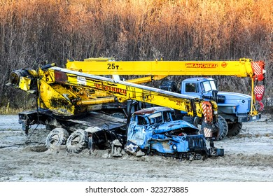 NOVYY URENGOY, RUSSIA - SEPTEMBER 23, 2015: Mobile crane Ural 4320 after a heavy crash at the countryside.