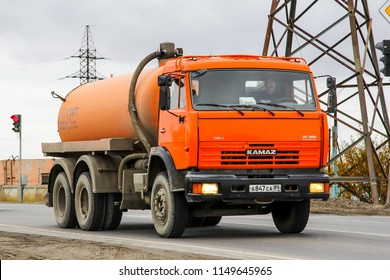 Novyy Urengoy, Russia - September 4, 2015: Sewage disposal truck Kamaz 65115 in the city street.