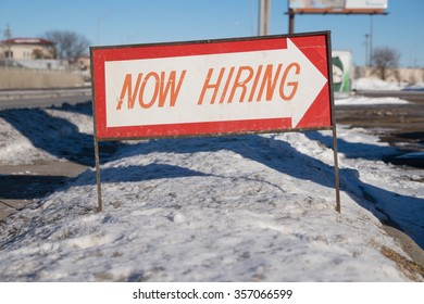 Now hiring sign in snow.