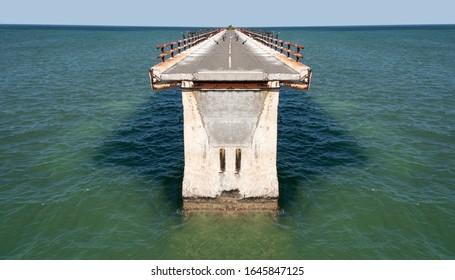 Nowhere leading bridge on ocean