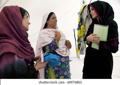 NOWSHERA, PAKISTAN - SEPT 7: UNHCR Goodwill Ambassador, Angelina Jolie  talks with flood affected women during her visits at Kandaro II Camp in Nowshera, Pakistan on Sept 07, 2010