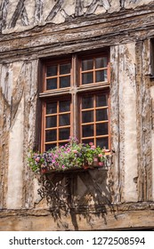 Noyers-sur-Serein Yonne Bourgogne-Franche-Comte France 18th July 2017 colorful window sill