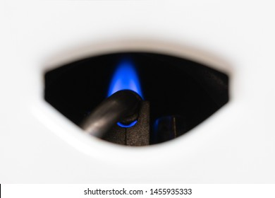 Nozzle and fire gas boiler close-up. white background. The boiler is in standby mode. the concept of carbon monoxide leakage and poisoning. safety of exploitation.