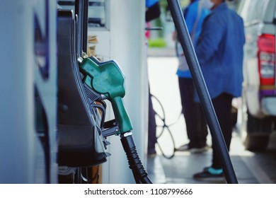 nozzle fuel for fill oil into car tank at pump gas station, transportation business technology concept, vintage tone