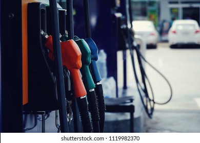 nozzle fuel for fill oil into car tank at pump gas station, transport energy, transportation business technology concept, vintage tone