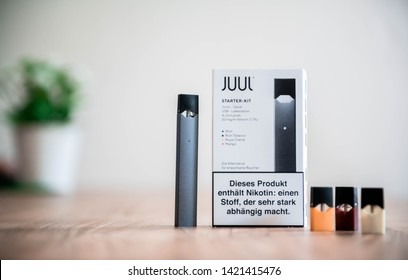 NRW/GERMANY - JUNE 11, 2019: A JUUL Starter Kit on a table. The company started selling the electronic cigarettes in Germany and has been criticized for marketing the product to teenagers.