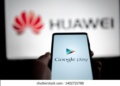 NRW/GERMANY - MAY 20, 2019: A man holds an android-smartphone that shows the logo for the google play store in front of the huawei logo. Google is restricting Huawei's access to its Android system.