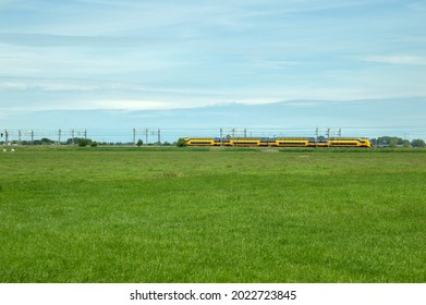 NS Train In The Background At A Farmland At Abcoude The Netherlands 17-6-2020