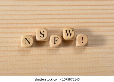 Nsfw word on wooden cubes. Nsfw concept