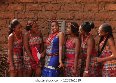 Nsukka, Enugu, Nigeria - 20 Feb. 2016: African bride poses for picture with her maiden friends before going out to welcome the family of the groom on her traditional wedding day.