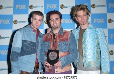 NSYNC stars JUSTIN TIMBERLAKE, JC CHASEZ & CHRIS KIRKPATRICK at the 2001 Blockbuster Awards in Los Angeles. 10APR2001.    Paul Smith/Featureflash