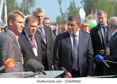 N.TAGIL, RUSSIA-AUG 22: Governor Sverdlovsk region Evgeny Kuyvashev and Deputy Chairman of the government Alexander Petrov on RUSSIAN DEFENCE EXPO 2012 on August, 22, 2012 at N.Tagil, Russia