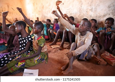 NTCHISI, MALAWI - JUNE 29, 2018: Unidentified students in a classroom of a primary school in a remote village near Ntchisi. Malawi is one of the poorest countries in the world.