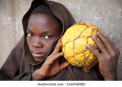 NTCHISI, MALAWI - JUNE 30, 2018: Unidentified young football player in a remote village near Ntchisi. Malawi is one of the poorest countries in the world.