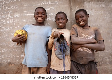 NTCHISI, MALAWI - JUNE 30, 2018: A group of unidentified young football players in a remote village near Ntchisi. Malawi is one of the poorest countries in the world.