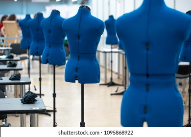 nterior of garment factory shop. Closes making atelier with several sewing machines. Tailoring industry.