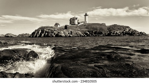 Nubble Lighthouse on a beautiful clear day in sepia tone