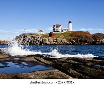 Nubble lighthouse with rough splashing waves