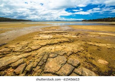 Nubeena Road, wild Koonya drammatic landscape with cloudy sky and rocky beach in the Tasman Peninsula in Tasmania, Australia