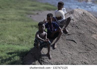 nubian boys sit on a rock - location nubian village aswan egypt  22/8/2016
