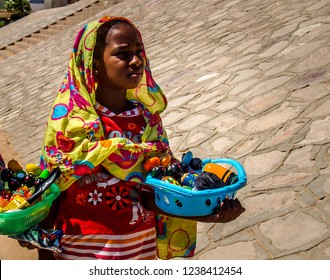 Nubian girl selling souvenirs for tourists in the village of West Suhail Nuba Aswan South 2014