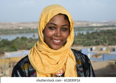 Nubian girl stands in the Nubian village,the nile behind her in aswan,Egypt