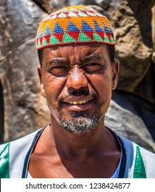 A Nubian man wearing a traditional Nubian costume stands in front of a Nubian house in the village of West Suhail al-Nuba, Aswan, southern Egypt 2014