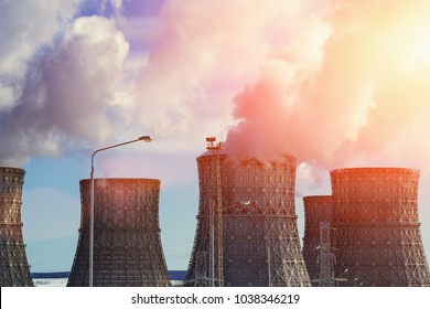 Nuclear Power Plant, clouds of thick smoke from cooling towers or chimneys, atomic nuclear energy concept, toned
